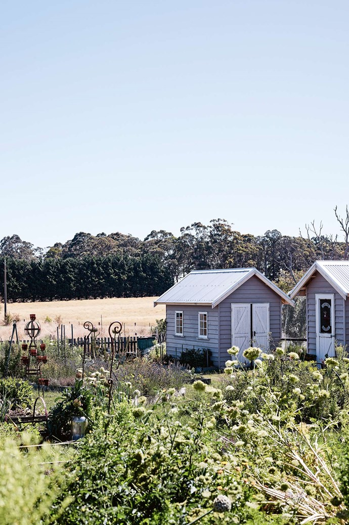 """The kitchen garden, with its pretty sheds, also has a beehive. In this cleverly combined family home, there's privacy, communal spaces and a sweet spot for everyone. """"On summer evenings, I love curling up on my favourite cane chair overlooking the paddocks and the colours of the garden harmonising with the setting sky,"""" Kate muses. For further information on Garçonne, visit their [website](https://garconne.com.au/). 