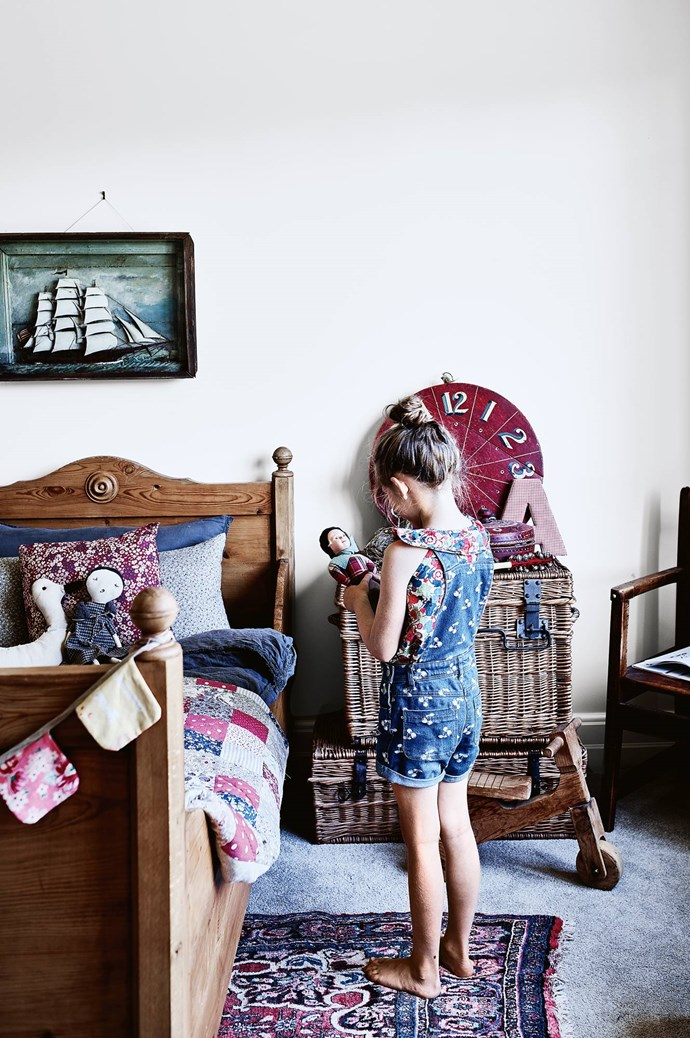 Lotti in her bedroom, where Dave assembled the bed from separate end and side pieces found on eBay. Kate made the patchwork quilt.  | Photo: Mark Roper