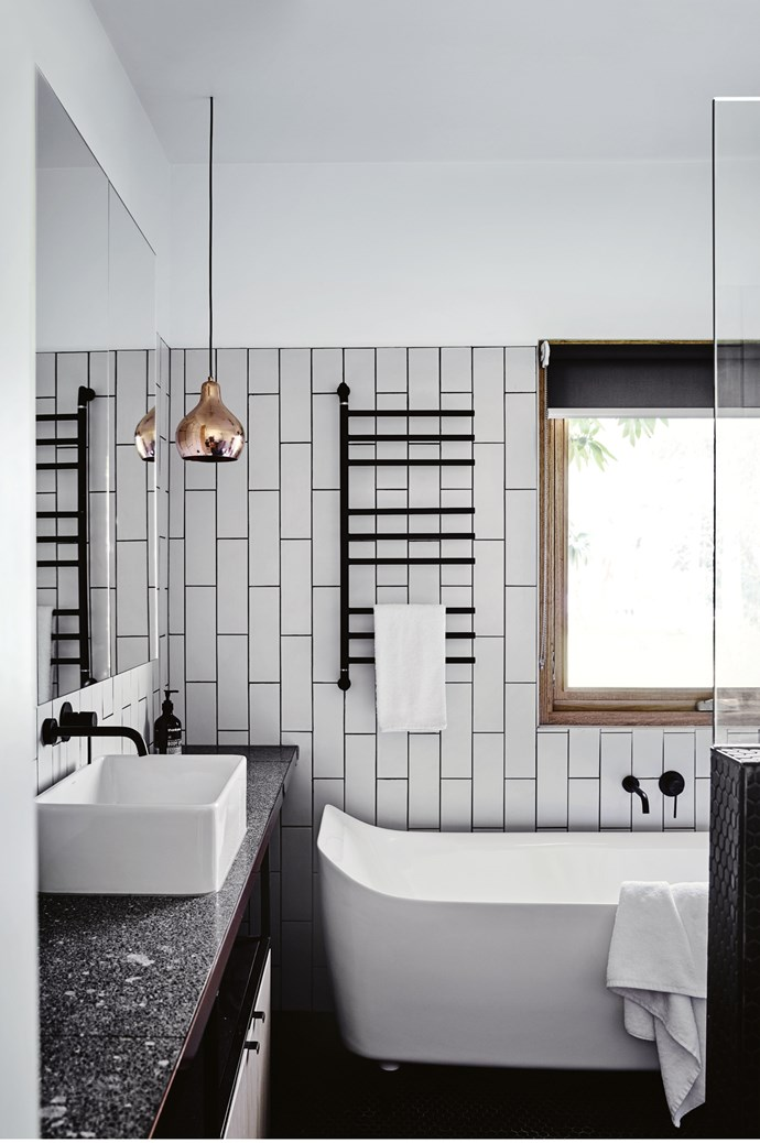 3. Conjure up some low-key luxury with a modern black-and-white palette and some high-end materials. This bathroom is all about clean lines. Copper and terrazzo brings a lovely tactile feel.  | Photo: Sharyn Cairns
