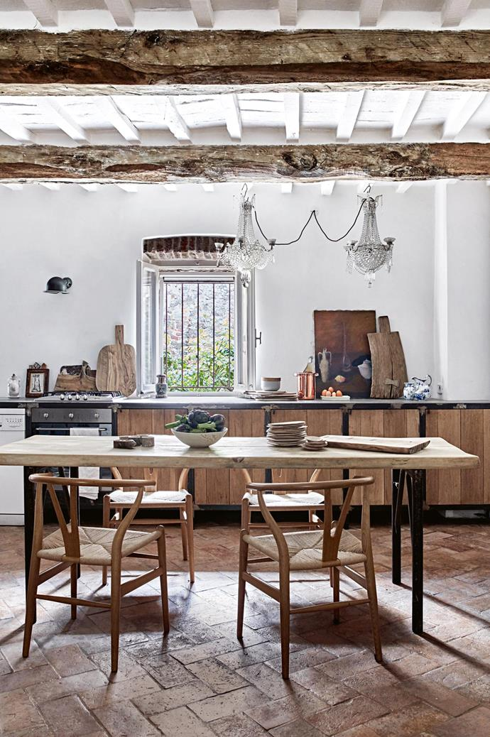 """Tactile timber finishes and rustic wares inject character and soul into this charming [country kitchen](https://www.homestolove.com.au/country-kitchen-design-ideas-13266