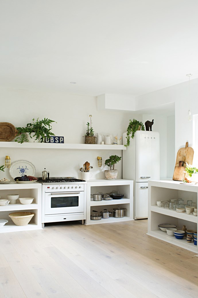 5. Display your beautiful curios in open-plan designs. Open shelves are allow you to rearrange bowls, glassware and pretty kitchen paraphernalia. This particular kitchen also includes a tadelakt — a traditional Moroccan lime plaster finish, which is rammed and polished, and applied over a Hebel block structure for the benchtop here.  | Photo: Kara Rosenlund