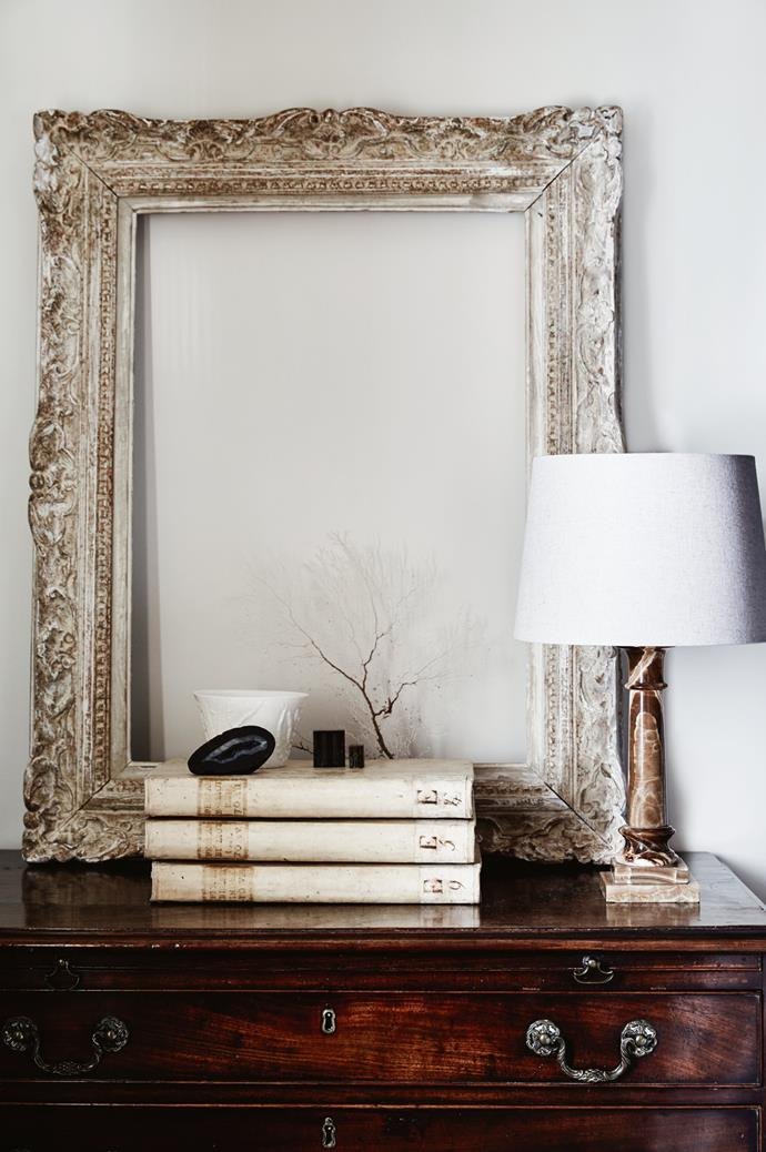 The Bairds bought the marble-based lamp (one of a pair) in Venice. It sits on a Georgian bachelor chest, alongside an antique French frame.
