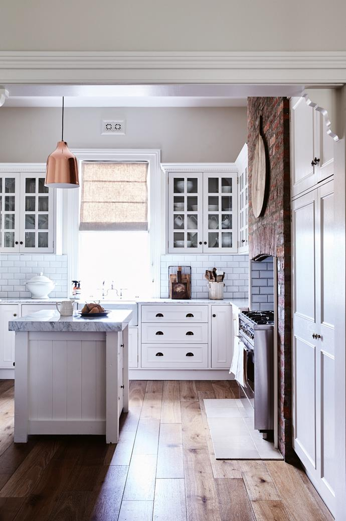 """The kitchen has been renovated with Tasmanian oak cabinetry, subway tiles and French oak flooring. The [island bench](https://www.homestolove.com.au/8-kitchen-islands-to-inspire-your-next-kitchen-renovation-5686