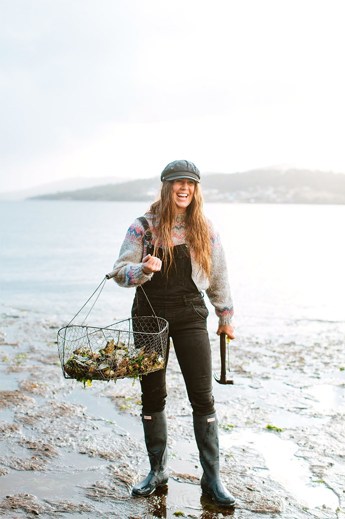 Sarah forages for her own shellfish, comfortably attired in overalls and Hunter boots.    Photo: Luisa Brimble