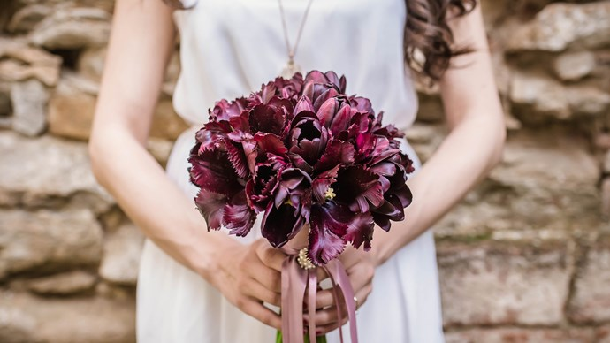 Everyone knows a wedding is a May-jor affair. There's so much to say about your glorious day, so let's say it with flowers. These are the top 10 blooms featured in the bouquets of May brides. 1. Tulips. These black tulips symbolise strength, power and royalty — and without question, every bride is a queen. Image courtesy of Artsy Vibes.