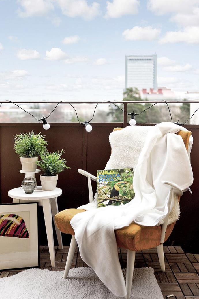 "String up some [fairy lights](https://www.homestolove.com.au/how-to-decorate-with-fairy-lights-3137|target=""_blank"") around your balcony reading nook, and keep turning the pages from daylight to dark."