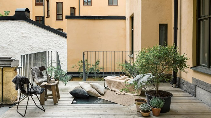 Lay low by ditching furniture and relaxing on your balcony floor. Source some stylish cushions and find warm blankets to cuddle up with on cooler nights. Image courtesy of [Anna Malmberg | Fantastic Frank]