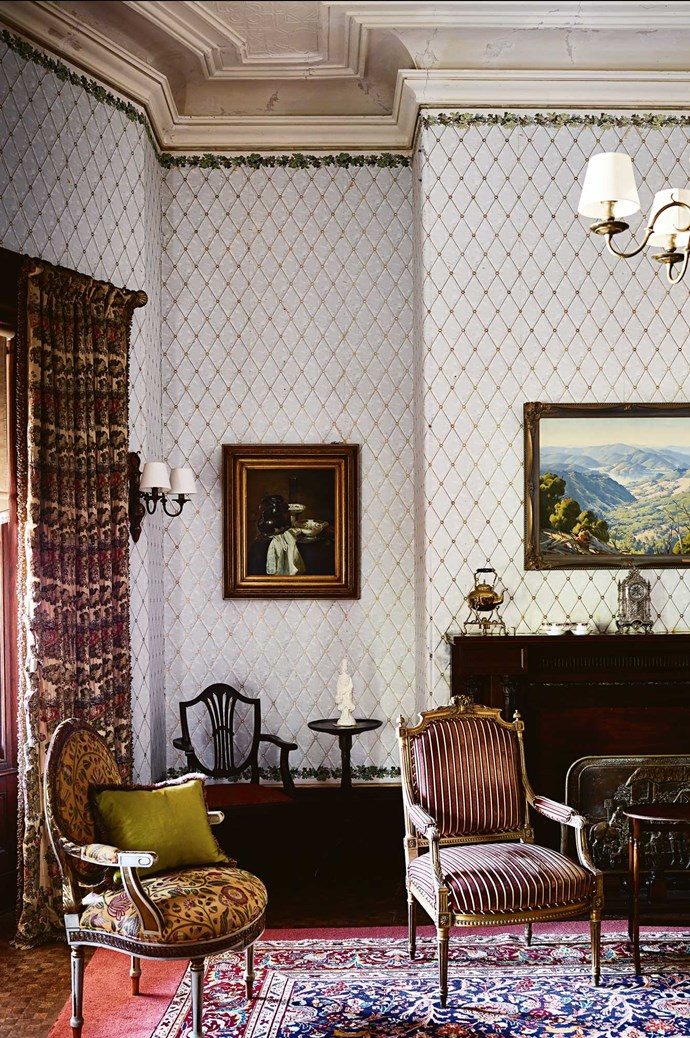 """The drawing room still has original wallpaper and heavy curtains woven with silver thread. """"There are thousands of pure silver threads running the entire length of the curtains, and we've had a quote for restoring them, and we're looking down the barrel of $100,000,"""" says Andrew."""