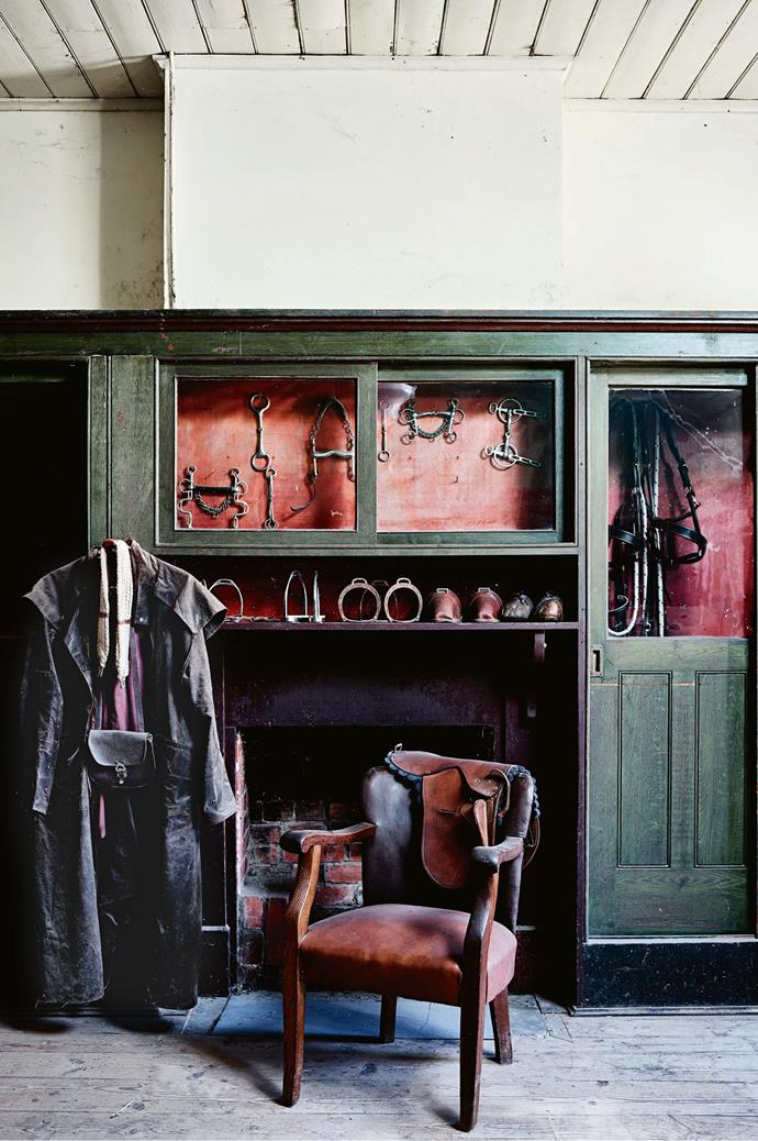 Horse riding tack is displayed in glass cabinets in the harness room, one of the station's many historic outbuildings.