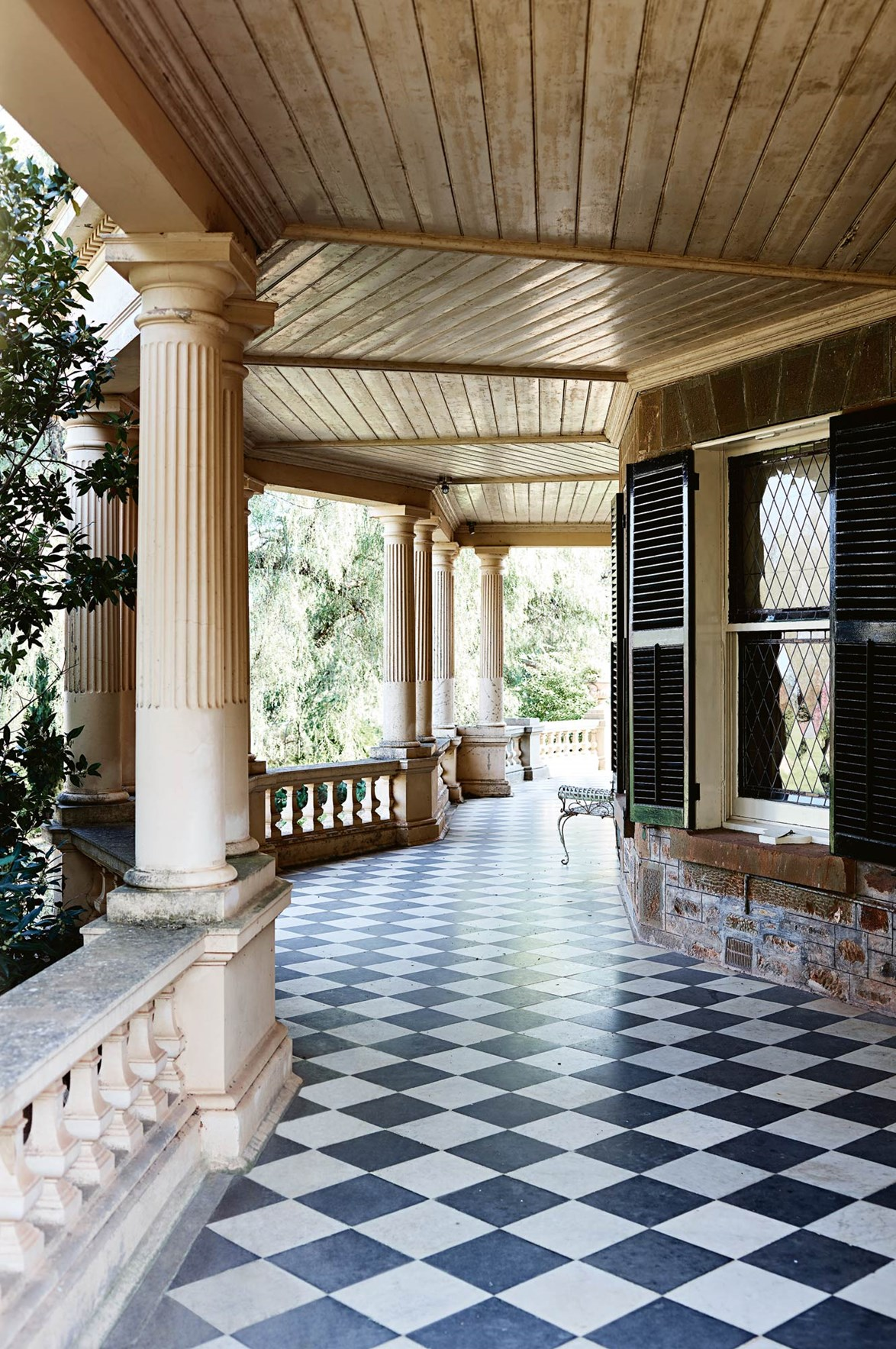 "The [historic homestead at Anlaby Station](https://www.homestolove.com.au/one-of-the-oldest-and-grandest-homesteads-in-the-barossa-valley-14038|target=""_blank"") features a grand front verandah. Black and white floors and fluted columns make for an imposing first impression. *Photo: Mark Roper / Stylist: Lee Blaylock*"