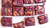 Gluten-free banana brownies with raspberry topping
