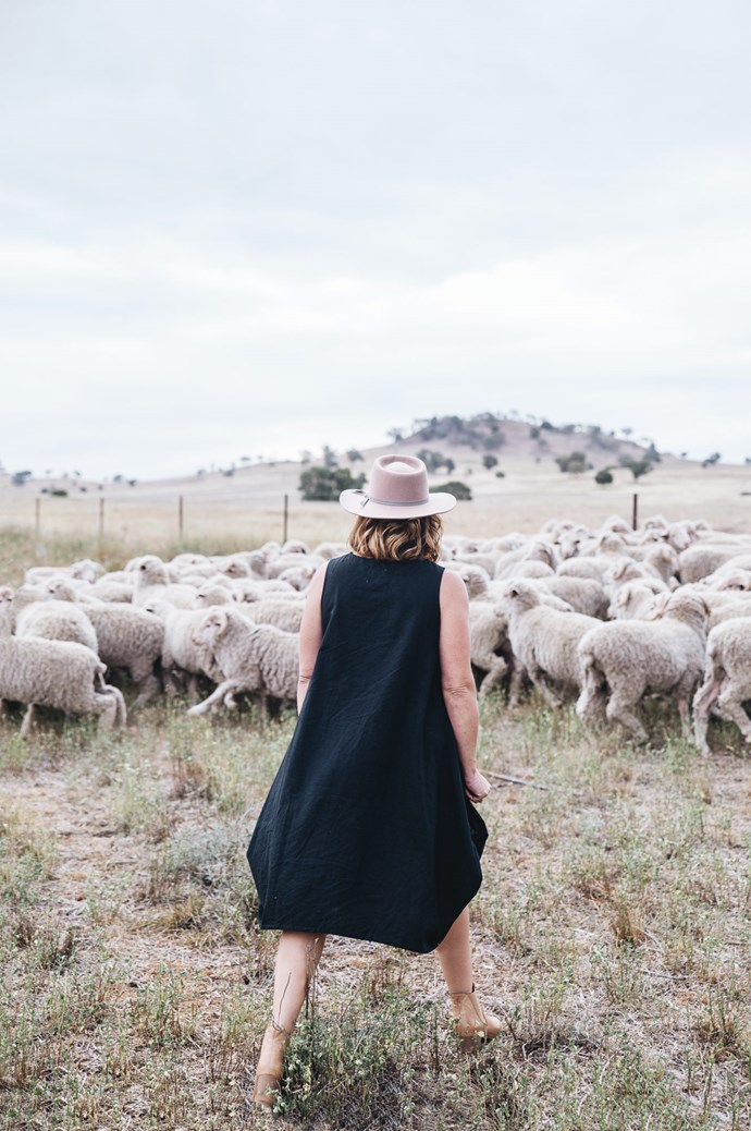 The merino sheep stud Mardi runs with her husband Hugh. Mardi wears a Keegan the Label dress from [Frank and Enid](https://www.frankandenid.store/) and [Lack of Color](https://www.lackofcolor.com.au/) hat. | Photo: Abbie Melle