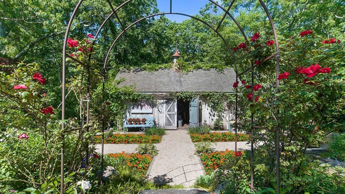 Grounds with rolling lawns, flower and organic vegetable gardens and walking trails also include a tennis court, pond and heated swimming pool.