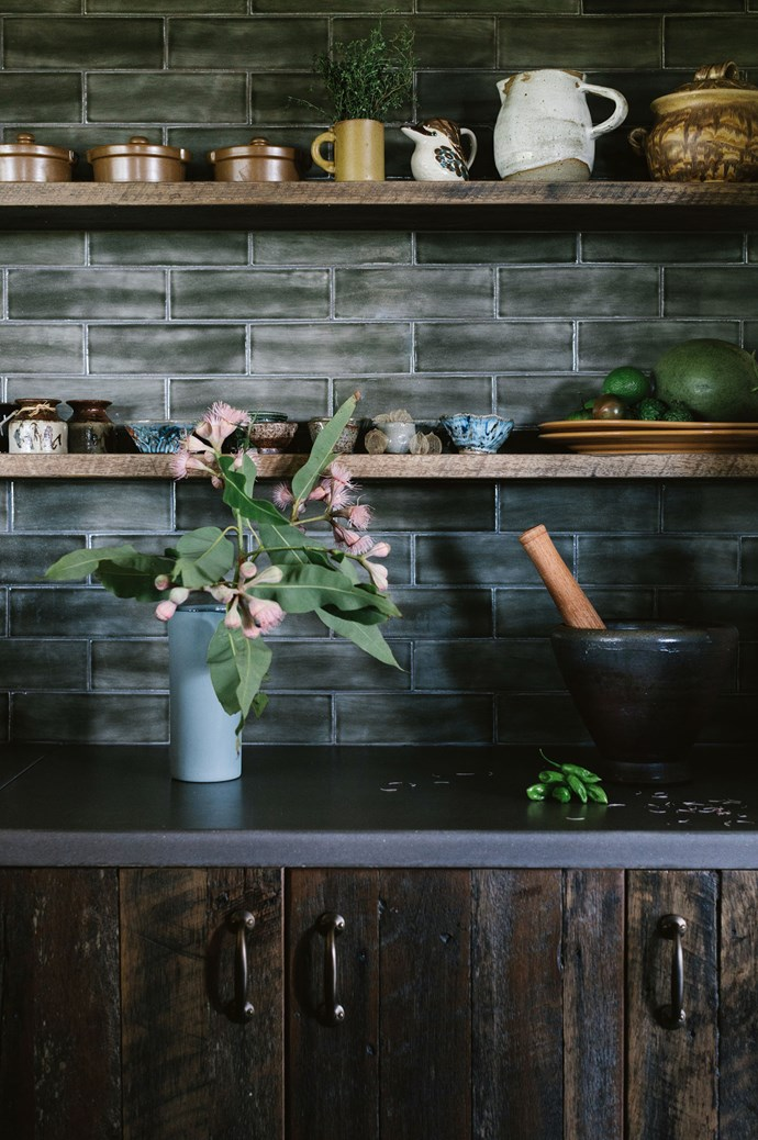 Aside from the white [Anna Karina](https://www.instagram.com/annakarinae/?hl=en) jug on the top shelf, almost all the ceramics have been bought at north coast markets. Garden produce includes frigitello peppers, kaffir lime, shark fin melon and black cherokee tomato. | Photo: Marnie Hawson