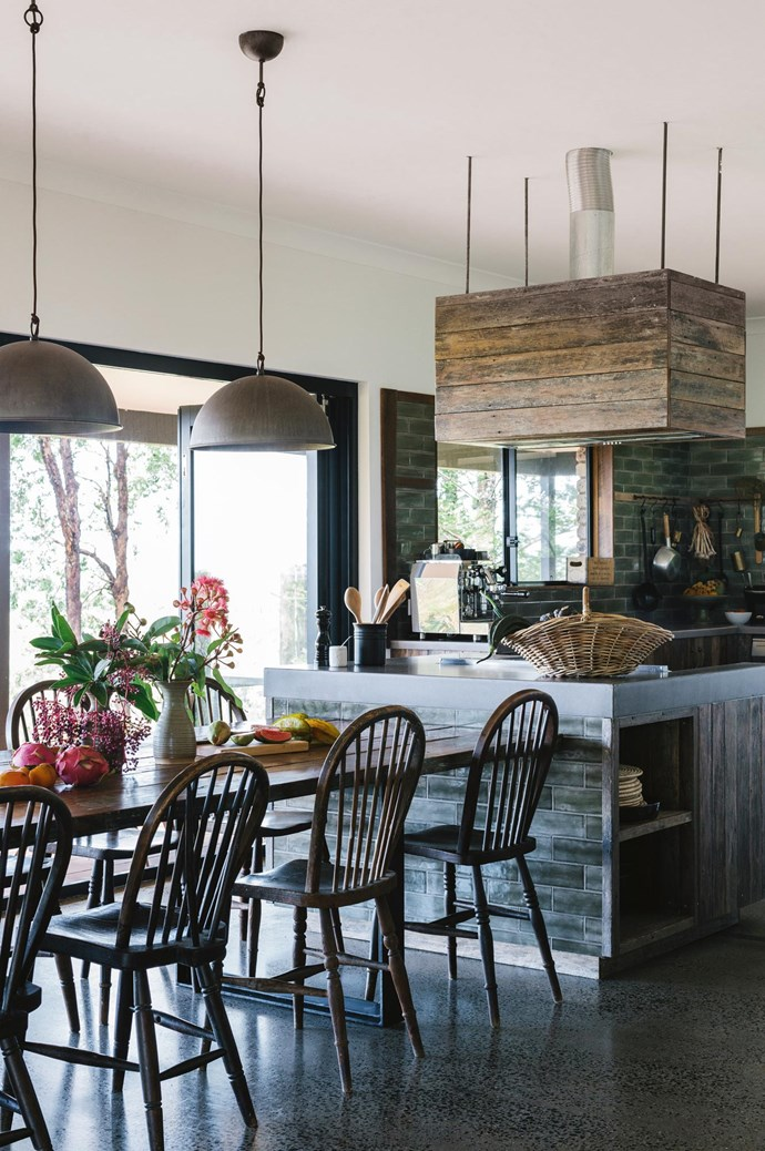 The farm's single-storey 1980s brick house has a kitchen with new timber cladding and tiles. Garden produce  on the dining table includes persimmon, pink Hawaiian guava, star fruit and red dragon fruit.  | Photo: Marnie Hawson