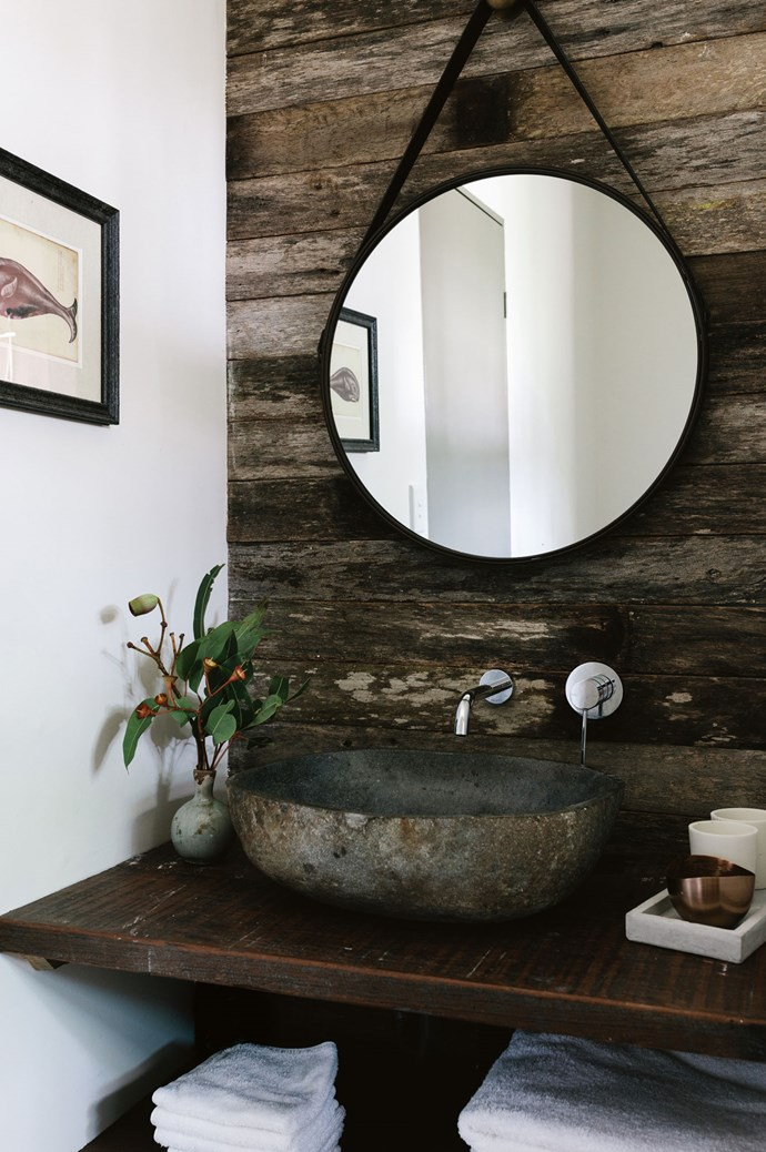 The bathroom features an oversized stone basin and a mirror from Kmart.  | Photo: Marnie Hawson