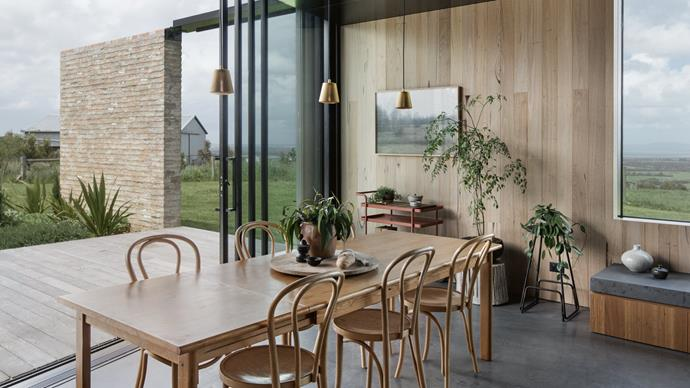 Overlooking a majestic backdrop of the South Gippsland hills, [The Hoddle](http://www.homelife.com.au/country-style/sustainable-timber-home-overlooking-the-south-gippsland-hills?ref=/search) is a compact, sustainable home built from natural timbers, including its kitchen. A large servery grants visual access to the living area, where glass doors slide open to outdoor entertaining areas. Silvertop ash cabinetry contrasts with the home's black architectural accents. *Photo: Ben Hosking*