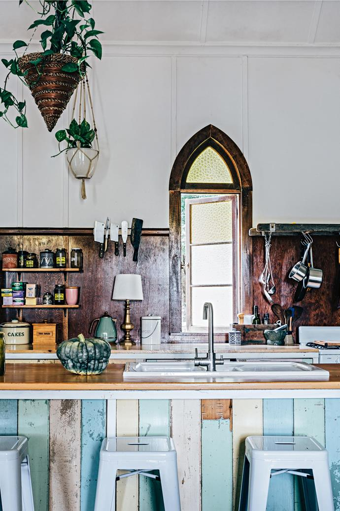 The benchtop of this country kitchen was handmade from a church pew by Andrew Morris, who runs [Church Farm General Store](http://www.homelife.com.au/country-style/homes-and-gardens/the-church-that-became-a-family-home) from his renovated church home with wife Amanda Callan. The coloured supports are recycled boards from the home of Amanda's sister.