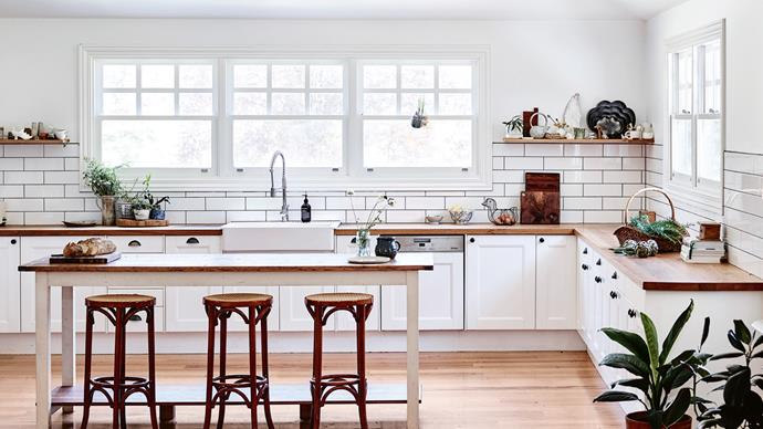 Before artist Elizabeth Barnett moved into [this weatherboard farmhouse](http://www.homelife.com.au/country-style/artists-bright-weatherboard-farmhouse-in-the-macedon-ranges?ref=/search), it was owned by a furniture maker who refurbished all the home's cabinetry and joinery, including this kitchen. The marble-topped carving table is an heirloom from Elizabeth's grandmother, furnished with three secondhand high stools. *Photo: Mark Roper*