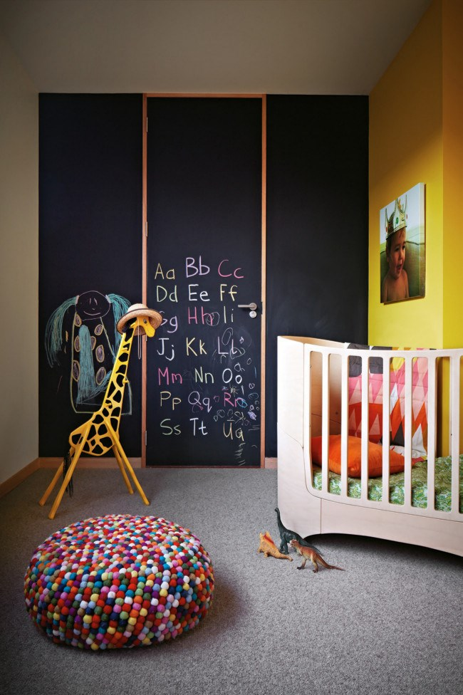 **Bright star** Avoid using a colour only once! Repetition is necessary to tie the space together and create balance. The bright yellow paint used on a feature wall in this room is also replicated in the rainbow stool, giraffe and [chalkboard](http://www.homelife.com.au/how+to/how+to+apply+chalkboard+paint,3547).  To see more of this house check out [Modern coastal home](http://www.homelife.com.au/homes/galleries/modern+coastal+home+,21953) | Photo: Armelle Habib