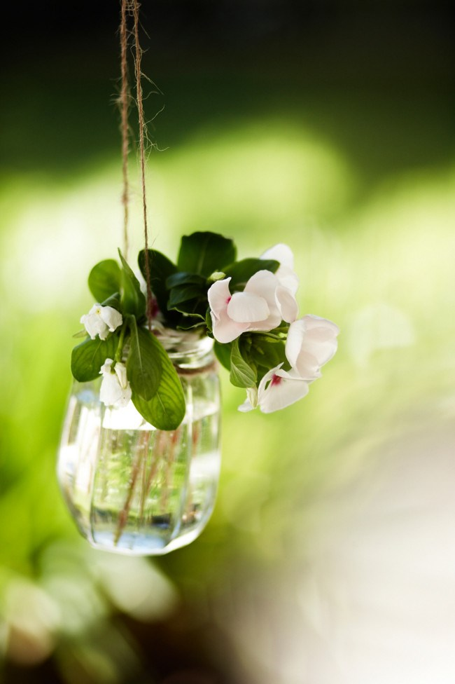 **Unique flowers** Half fill glass jars with water and place your favourite [blooms](http://www.homelife.com.au/gardening/plant+guides) in them. Tie ribbon, fabric or twine around the top and hang from tree branches for a romantic and very pretty look.  _Photo courtesy of [Rob Johnson Photography](http://robjohnsonphotography.com/)_