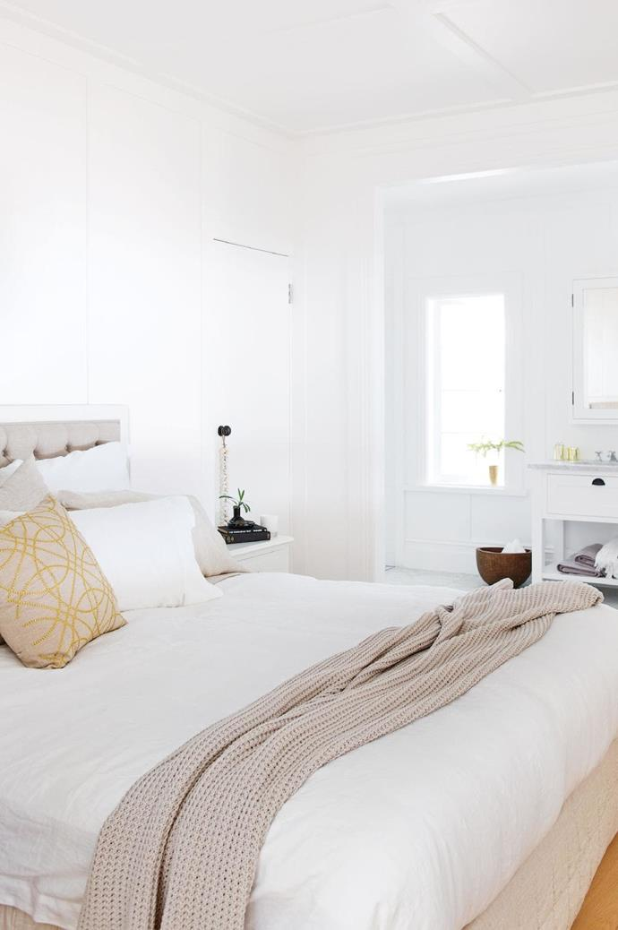 """'Abbotson' bedlinen from Sheridan gives this space its refined yet relaxing feel. A 'Haden' throw, 'Branay' cushion and towels in the ensuite, also from [Sheridan](http://www.sheridan.com.au