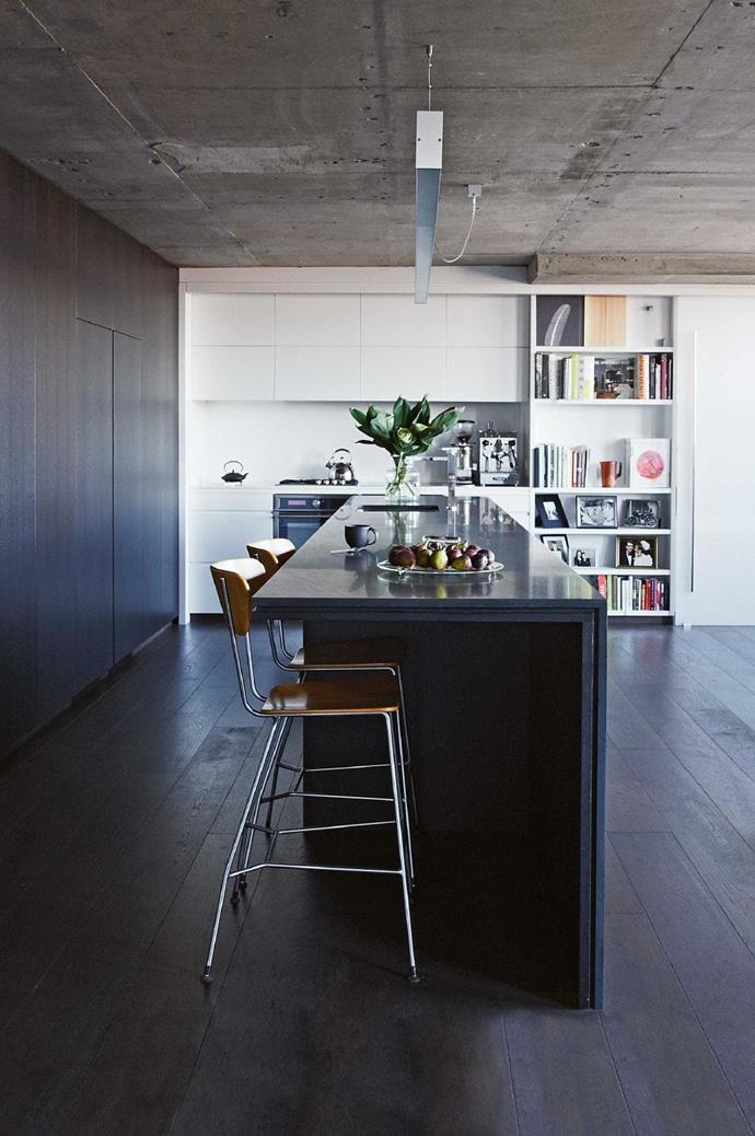 A concrete ceiling give the sleek elements of this kitchen from the cabinetry to the long kitchen bench a cool warehouse edge Stylist: Jessica Hanson, Photographer: Amanda Prior