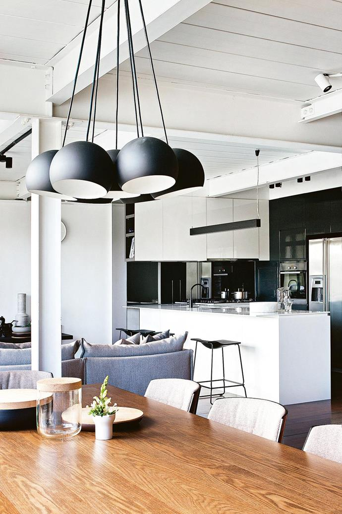 "According to architect Tisha Lee, the owner of this [heritage Melbourne apartment](https://www.homestolove.com.au/dream-it-a-melbourne-heritage-apartment-sticks-to-its-industrial-roots-15858|target=""_blank"") ""really enjoys cooking when he gets a chance, so there was a lot of emphasis on the kitchen being a place where he could celebrate what he was doing."" *Photographer: Rosanne Peach*"