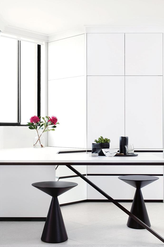 Timeless and futuristic all at once, this streamlined kitchen is the perfect fit for a Sydney couple. *Photo: Franoise Baudet*