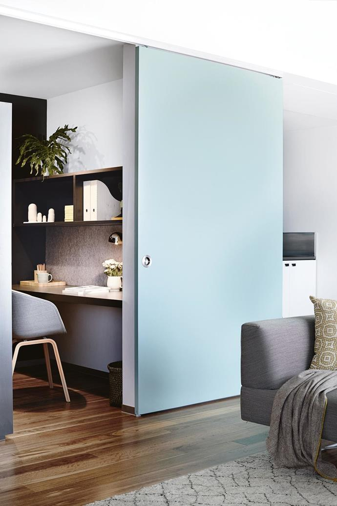 If your floorplan allows, consider sectioning off part of your living room to create a study nook. A sliding door is another space-saving solution for hiding your desk away when not in use. *Photo: Derek Swalwell*.