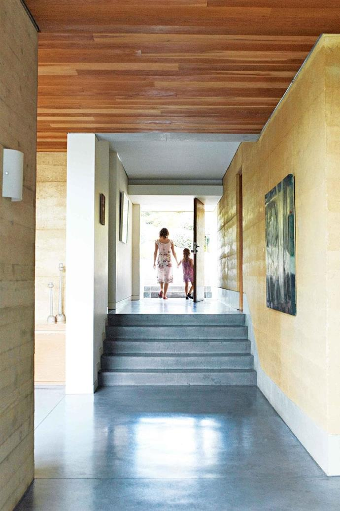 The light-filled entry is a mini gallery, accessed via smooth concrete stairs Stylist: Karen Cotton, Photographer: Prue Ruscoe