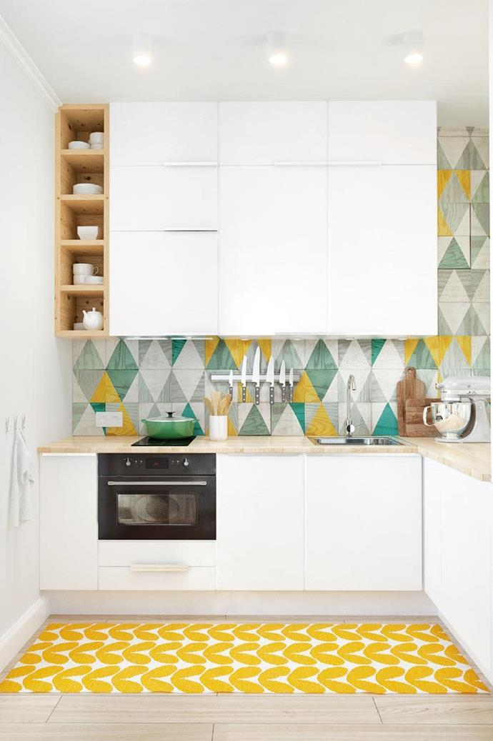"**Geometric** Patterned tiles again come to the fore in this compact kitchen space. The splashback incorporates bright yellow and muted greens to add a pop of playfulness to the white and timber space which is coupled with a colourful rug on the floor. *Design: [Spacecraft Joinery](http://spacecraftjoinery.com.au/|target=""_blank""