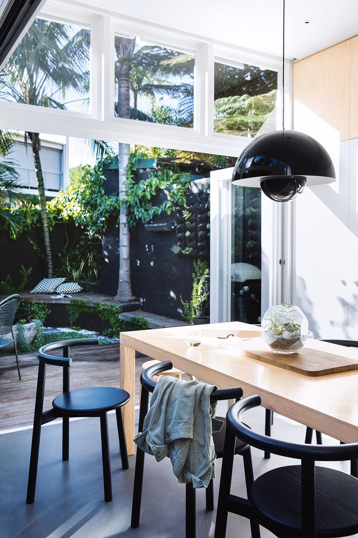 """An open-plan kitchen and dining room expands out onto a private courtyard affording the owners of this [minimalist style terrace house](https://www.homestolove.com.au/minimalist-inspiration-from-a-light-filled-terrace-18366