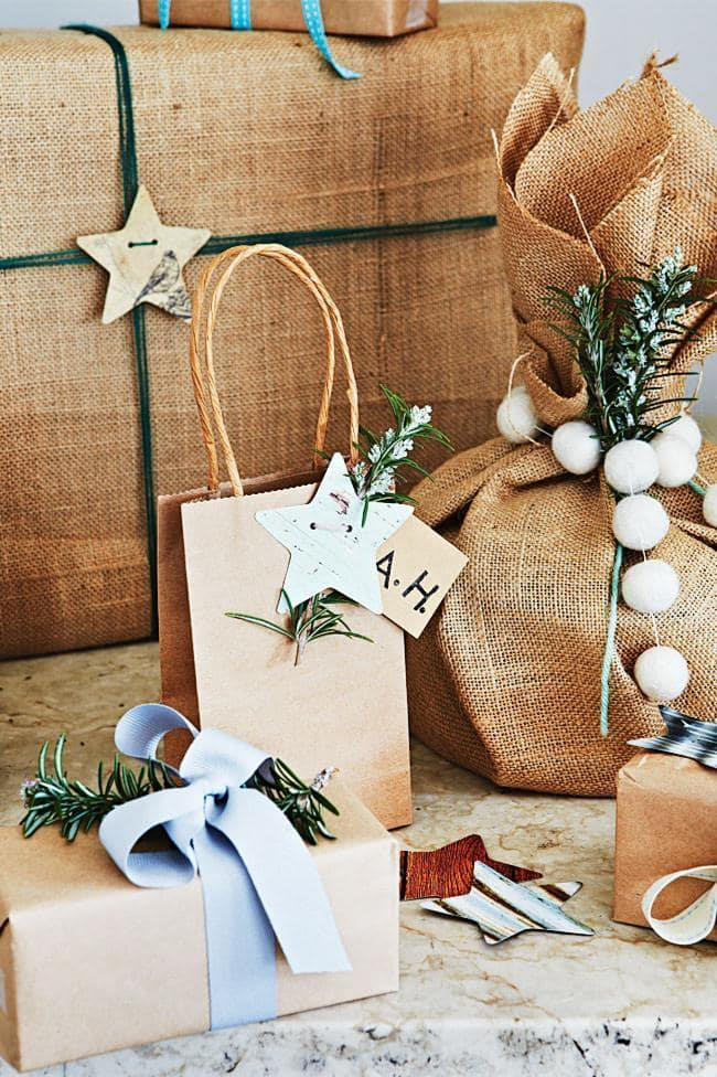 **Sprigs of rosemary make a lovely garnish for earthy wrapping** Photographer: Armelle Habib