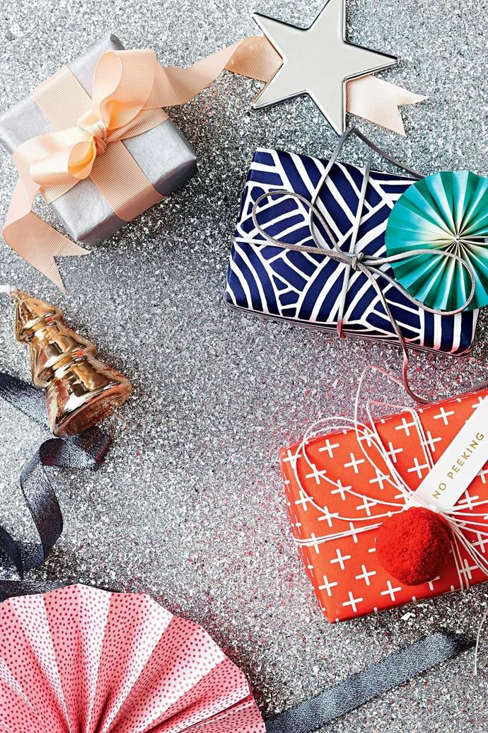 <b>Products</b> Ribbed peach ribbon and textured silver wrapping paper, Vandoros. 'Noel' star decoration in Silver, $8.95, Country Road. 'Japanese Wave' wrapping paper in Blue/White, $3/metre, Paper2. House Doctor leather ribbon in Silver, $9.95/5m roll, Milligram. 'Crosses/Woodland' double-sided gift wrap, $5.95/sheet, Bespoke Letterpress. Paper fans &amp; White twine, stylist's own. Raine &amp; Humble pom pom, $15.95/set of 6, Paper2. Letterpress Christmas flag tag in Gold on White, $8.95/assorted pack of 10, Inky Co. Metallic blue ribbon, Vandoros. Pine decoration in Gold, $19.95/set of 4, Country Road.