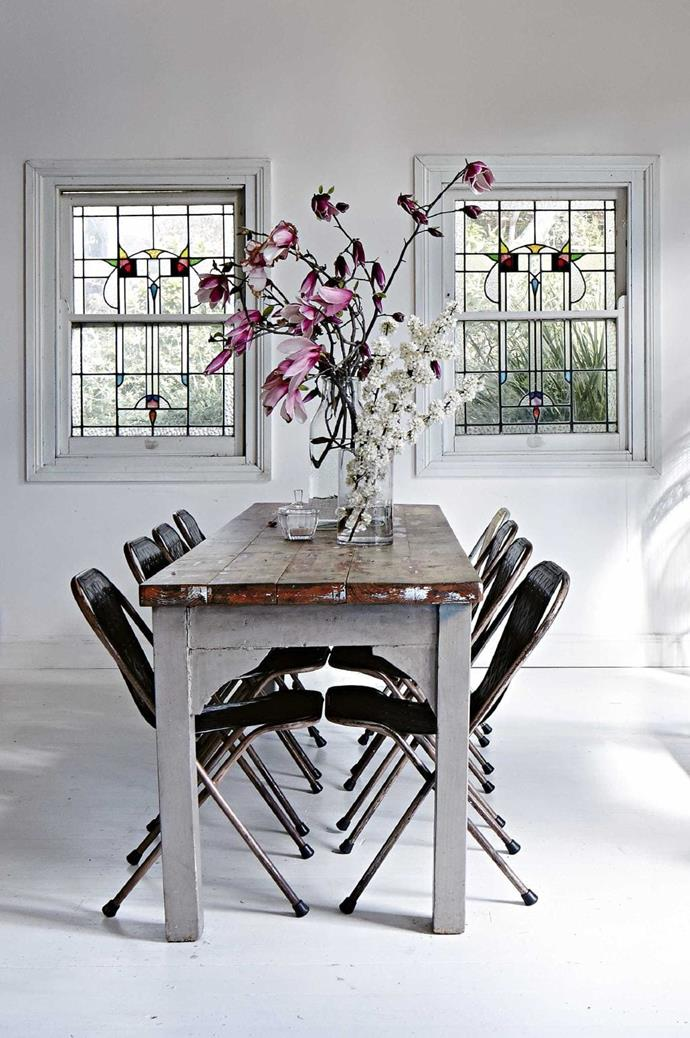 Look at buying from vintage or second-hand shops to create a look like this. Here, the dining table and Sebel chairs were bought on eBay. The table top was sanded back and given a polish while the chairs were spray painted black Photographer: Alicia Taylor, Stylist: Jane Frosh