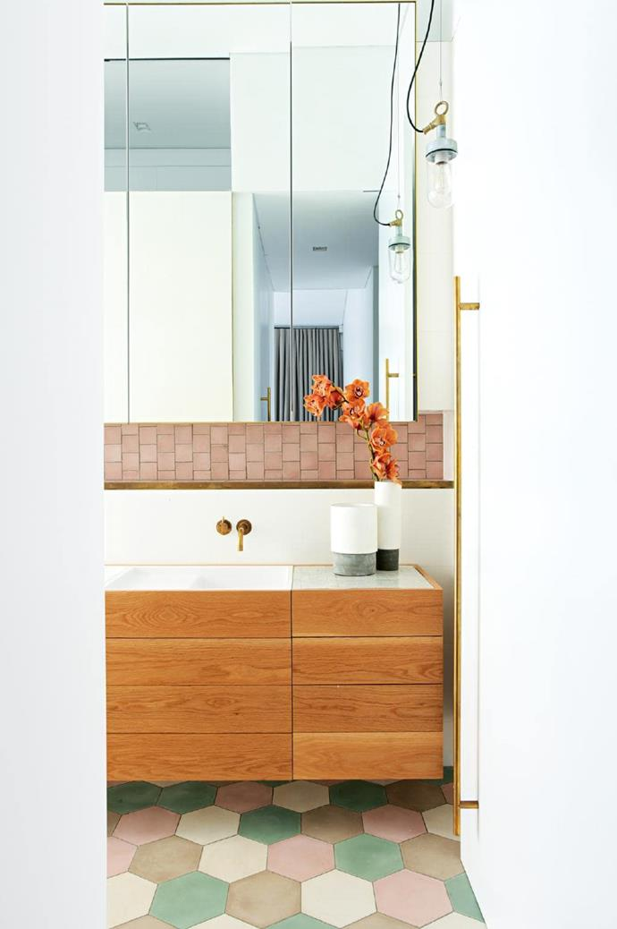 **Hex appeal**. Vintage bathrooms have a secret weapon: their amazing colour palettes. If you're a fan, take that musk pink and minty green and knock it right into the now with a timber vanity and brass taps. A large-format hexagon tile is an interesting take on the trend. Designed by [Pohio Adams Architects](http://www.pohioadams.com/) Photographer: Sharrin Rees