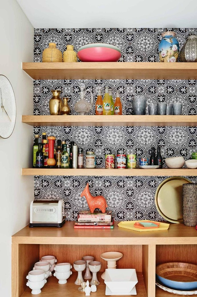 A bold wallpaper mirrors exotic patterned tiles behind plenty of open shelving in this pretty but practical butler's pantry. *Photography: Anson Smart | Styling: Maria Dyoniziak*