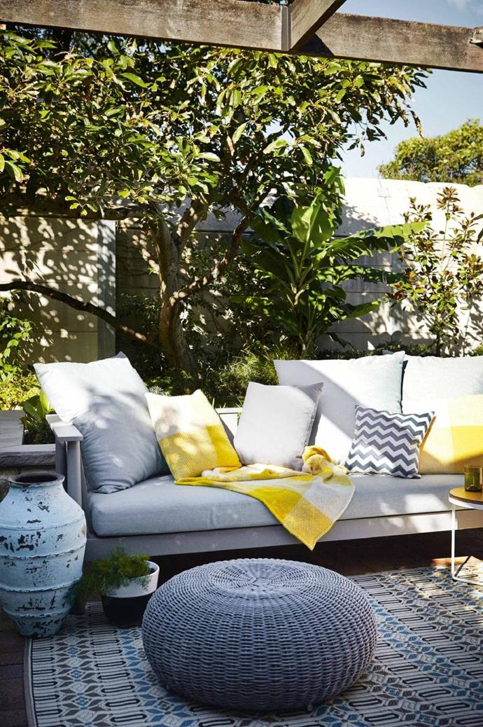 Add colour and comfort with furniture and accessories. Having inviting furniture and pops of colourful accessories will draw people into your outdoor area. Little additions such as throws, cushions, a side table and even an outdoor rug will make all the difference to creating a relaxing space for you and your guests to relax, enjoy and unwind in.