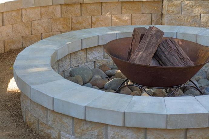 **Step 6: Finishing touches** <br> Install decorative rocks to line the interior of the pit. Place a steel bowl or metal fire ring in the centre to contain the flames. Set up outdoor reclining chairs, grab some marshmallows and invite a few friends over – you're all set to go.