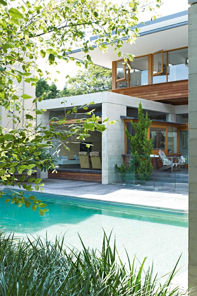 """The strong lines and minimalist style of the home extends to the exterior of the house with [natural timber decking](https://www.homestolove.com.au/5-tips-for-maintaining-a-timber-deck-14409