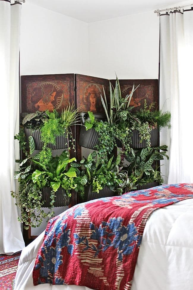 Greenery in the bedroom is like having your own natural purifier that rids the air of nasty toxins. Opt for shade-loving plants for the best results. Photography by Debra Szidon
