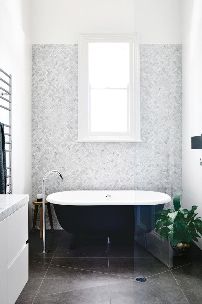 **Classic beauty**. It's often best to work with traditional architecture rather than against it (the window frame gives away this home's Victorian age). Choose a timeless combo like black, white and carrara marble, but have fun with the application. Mini herringbone tiles are a playful take on a luxe element and allow the stone's natural pattern to shine. Designed by [Austin Design Associates](http://austindesign.com.au/). Built by [Pop Building Group](http://www.popbuilding.com.au/) Photographer: Derek Swalwell, Stylist: Rachel Vigor