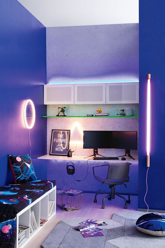 If you've got a teen with a passion for gaming, fire up their imagination with the ultimate set-up for a dedicated player. Space-age meets retro style in this fun, playful room.  <i>Styling by Jono Fleming and photography by Sam McAdam-Cooper</i>. 'Scamp' table, $299, Blu Dot. 'Bestå' frames, $30 each, 'Bestå' soft-closing hinges, $15/pack of 2, 'Bestå' suspension rails, $5 each, and 'Glassvik' glass doors, $30 each, (for top row of cabinets) IKEA.  <b>On top shelf</b>:  <i>Legend Of Zelda</i> statue, $129.95, Kings Comics. Lexon 'Flip' clock in Blue, $70, Top3 By Design. Pop!  <i>Pac-Man</i> vinyl figurine, $18.95, Kings Comics. Pop!  <i>Star Wars</i> 'Princess Leia With Speeder Bike' vinyl figurine, $54.95, Kings Comics. 'HomePod' smart speaker, $499, Apple.  <b>On desk</b>:  <i>Future</i> artwork, $290 (framed), Blacklist Studio. DC Comics Batman bust, $59.95, Kings Comics. 'ROG Swift PG258Q' monitors, $769 each, 'ROG Gladius II' mouse, $119, and 'Cerberus V2' gaming headset, $68, ASUS. Photographer: Sam McAdam-Cooper, Stylist: Jono Fleming