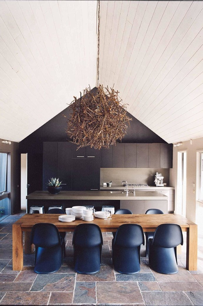 This grand space echoes the outdoors. From the warm colour palette and the 'Hedgehog' lightshade from [Mance Design](http://mance.com.au/) to the long timber table and slate floor Stylist: Glen Proebstel, Photographer: Sharyn Cairns
