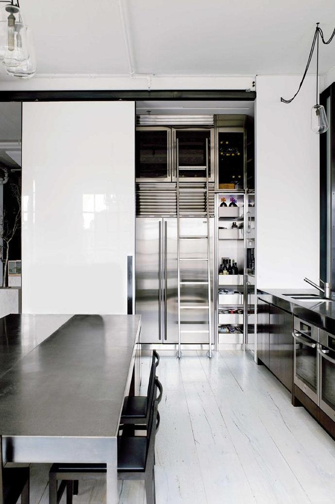 Featuring hard-wearing stainless steel, large preparation areas and open storage for easy access makes this kitchen design ideal for serious cooks Photographer: Richard Powers