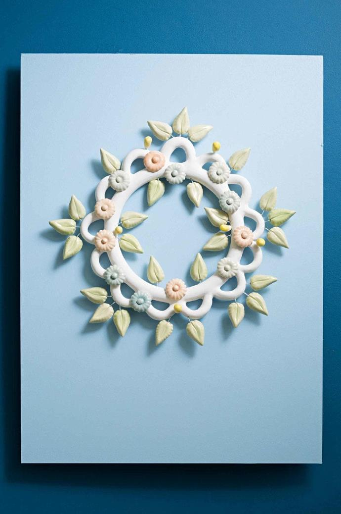 """BY [Ingrid Tufts](http://www.tufts.com.au/), ceramicist: """"My current work is about celebration and decorations, so for the upcoming festive season, I'm using a soft, fresh palette for both tableware and decorative pieces. The wreath is decorated with ceramic leaves and flowers, and glazed in pastel tones for a springtime feel. I've had a lifelong love of Mexican folk ceramics, so I wanted to create a wreath inspired by handcrafted boho pieces"""" Photographer: Craig Wall, Stylist: Jessica Hanson"""