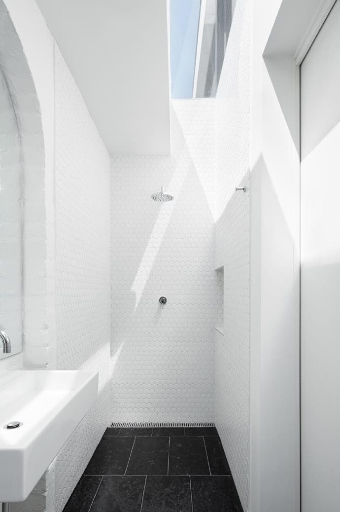 **The light box**. No window? No problem! Sometimes it takes an architect to come up with a creative solution, and this is a perfect example. A long narrow room is brought to life by a slender skylight, bringing in natural light and even a sliver of blue sky from above. White tiles bounce the light around so the small room doesn't feel oppressive. Design and image by [Tom Robertson Architects](http://www.tomrobertson.com.au/)