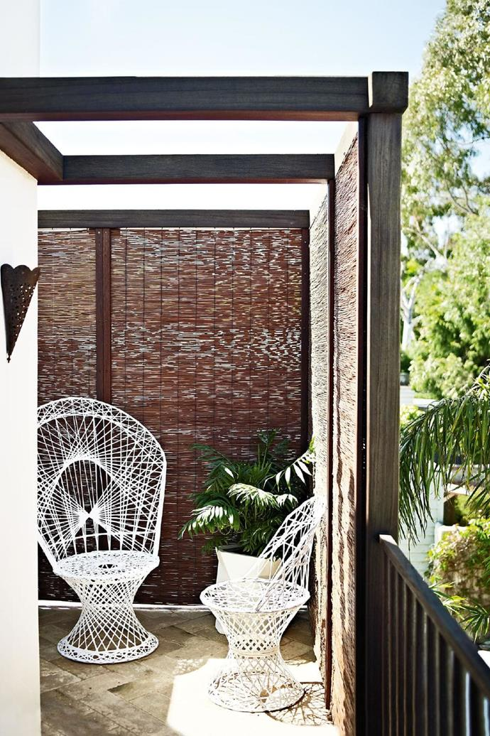 Wicker from Los Angeles markets furnishes the master bedroom's balcony Stylist: Glen Proebstel, Photographer: Mark Roper