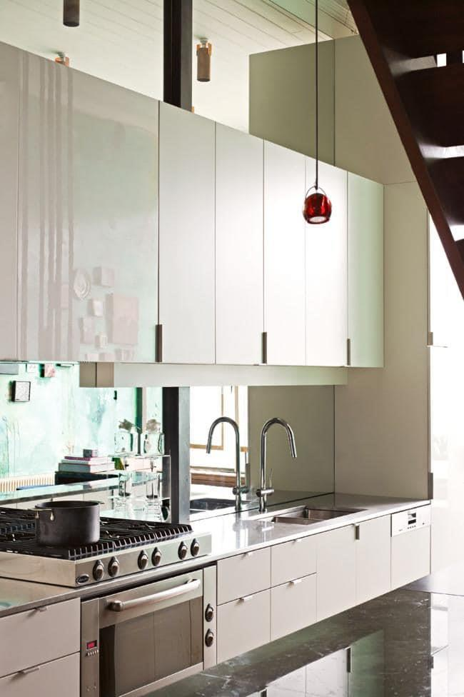 A mirrored kitchen splashback not only reflects light it also adds to the sense of space.